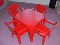 Red plastic table + 4 chairs