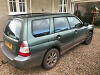 Subaru Forrester AWD 2.0 petrol. 90,000 miles. MOT Sep 18. With boot screen, dog guard and roof rack