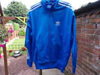 BLUE ADIDAS ZIP UP TOP S/M SIZE WISE AND IN GOOD CONDITION ..