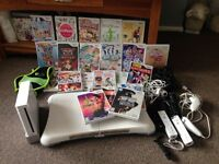 Nintendo wii with 23 games, wii board and accessories