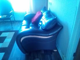 2 X TWO SEATER DARK BROWN LEATHER SOFAS