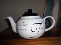 Teapot like new. Script design. Black and white. Excellent condition as barely used.