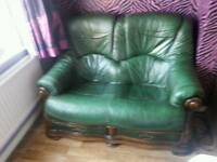 Green two seater sofa with draws