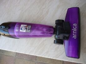 quality arnica slim light weight up right bag less vacum cleaner in excellent condition,only £49..