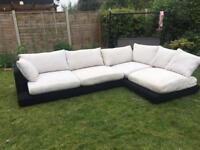 Black and beige large corner sofa