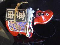 Wooden Oriental ornament of nodding animal