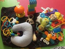 Random baby teething toys , feeding shawl, taglets and baby toys