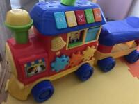 Toddlers train to sit on and ride. Also has buttons for sounds