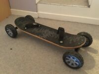 Skateboard with feet straps. Almost new.
