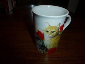 Cat and kitten mug with poppy and daisy design