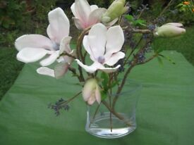 Artificial Flowers Set in a Clear Glass Vase