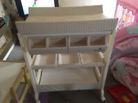 Baby low elephant changer has a bath inside and shelf's for nappies and other thing