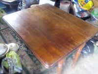 Old dining table with fold down leafs