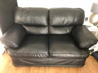 Two seater black leather settee