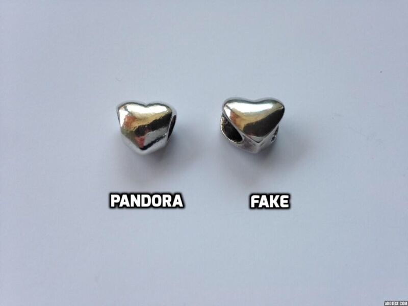 This photo clearly shows that the fake charm could not be threaded or screwed onto a Pandora bracelet.