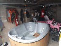 Hot tub , granite grey, wooden surround , multicolour lighting