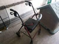 Four wheeled walking frame seat