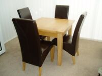 CONWAY SOLID OAK DINING TABLE AND FOUR LEATHER DINING CHAIRS