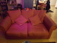 FREE TO COLLECTOR Red two seater sofa