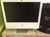 I mac computer with keyboard and mouse