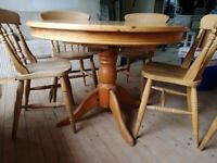 Solid wood extending dining table with 5 chairs, can deliver locally