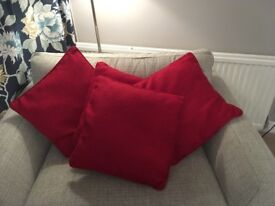 Four rich red, good quality cushions