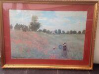 Framed Monet print in gold frame