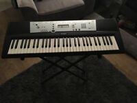 Yamaha full-size keyboard with stand