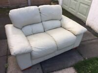 Two seater Cream Leather Sofa. Retro style and in decent condition. No damage to leather just TLC.