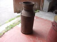 old steel milk can with strainer and wooden churn