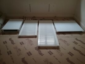 4 radiators in different sizes and thermostat valves for sale - good condition