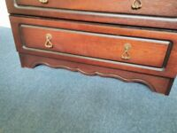 Dark wood effect chest of 5 drawers