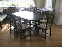 VERY LONG STURDY OVAL EXTENDING TABLE & 8 LADDER BACK ORNATE CHAIRS.VIEWING/DELIVERY AVAILABLE
