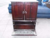 MAHOGANY STORAGE TV STAND OR CUPBOARD IN GOOD CLEAN CONDITION NICE DESIGN ON GLASS DELIVERY FREE