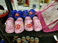 kids shoes and pink and white school bags