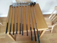 Set of 6 matching irons and 4 other mixed adult, right-handed men's golf clubs, including putter.