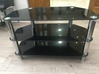 """In good condition Tv Stand form 32"""" and bigger ."""