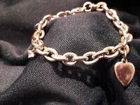 Silver charm bracelet - almost new