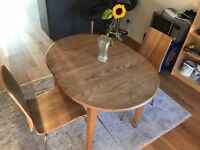 Used extendable dining table with 2 chairs