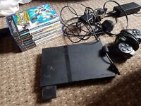 PS2 for sale with some games