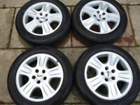 """FORD 16"""" 5 STUD ALLOY WHEELS WITH MINT TYRES AND SET OF NUTS"""