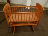 Wooden rocking crib in very good condition.