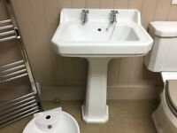 Traditional bathroom basin and pedestal with taps.old London.ex display