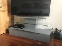 T.V. Stand for sale in wonderful condition nearly new, has two shelfs and one drawer.