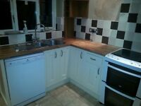 Cream wood kitchen units including appliances