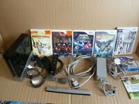 Nintendo Wii Bundle + 7 Games inc. Super Mario Galaxy, Resident Evil 4, The House of the Dead