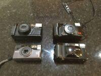 Four old Cameras