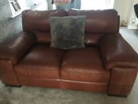 Tan leather 3 seater and 2 seater sofas £400