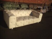 White leather Chesterfield style sofa and chair
