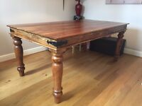 Solid wood 6/8 seater dining table.
